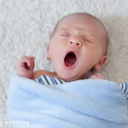 baby yawn white blanket