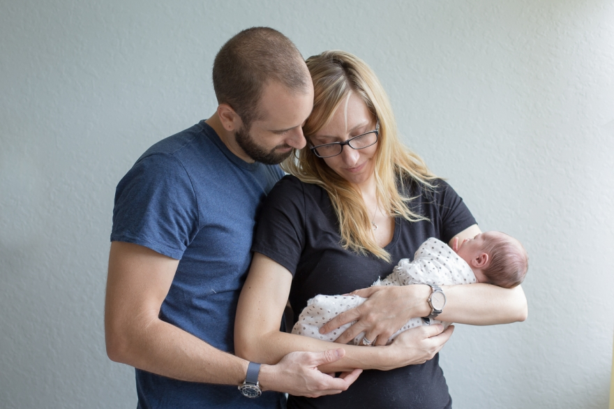 week old newborn lifestyle session with mom and dad